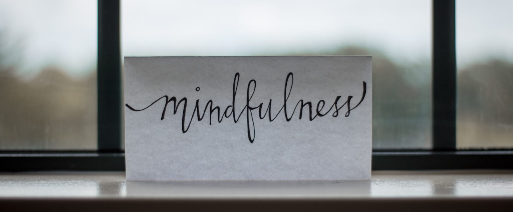 Card with Mindfulness Written on it in script