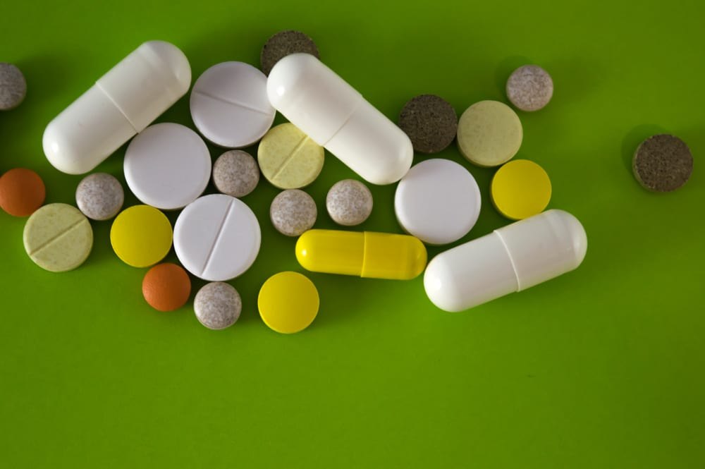 Various pills on a green table in Westmoreland County, PA